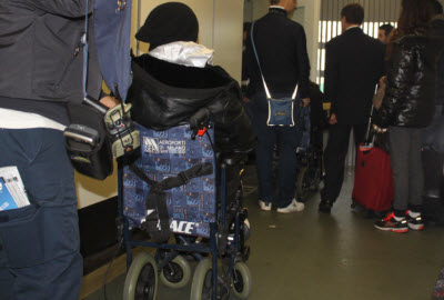 Access helping disabled passenger at Malpensa airport