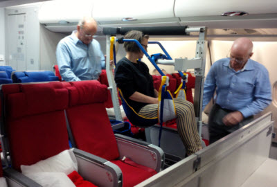Passenger lowered into aircraft seat