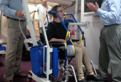 Passenger being lifted from wheelchair